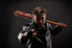Killer with bloody bat on black background. Stock Photos