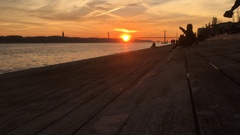 People Enjoying Beautiful Sunset In Lisbon Stock Footage