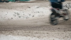 Motorcycle rides on motocross track in winter Stock Footage