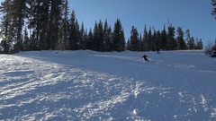 Skier skiing slope on sunny winter day Stock Footage