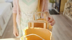 Young woman unpack two large paper bags with fresh organic friuts Stock Footage