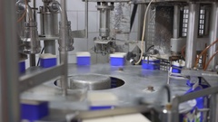 Milk boxing equipment at dairy plant Stock Footage