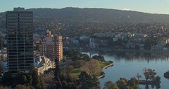 Aerial shot of Oakland City & lake merritt at sunrise Stock Footage