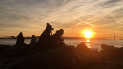 Silhouette Couple Filming Sunset By Tagus River In Lisbon Stock Footage