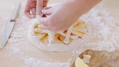 Woman makes fresh apple pie in her kitchen. Decorate pie Stock Footage