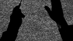 Silhouette tv noise baton hands Stock Footage