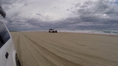 4x4 Vehicles driving along beach Stock Footage