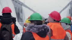 Media in work helmet and reflective vest at plant Stock Footage