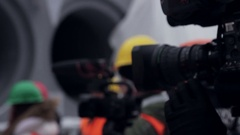 Camera. Work helmet and reflective vest at plant Stock Footage