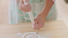 Girl by hands rolling dough for apple pie. Girl cooking apple pie Stock Footage