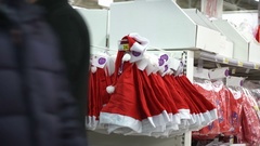Christmas shopping concept. Buying Santa Claus hat in hypermarket. Zoom in Stock Footage