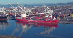 Aerial of container ship on the port of oakland, California, USA Stock Footage