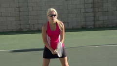 Women playing tennis, slow motion. Stock Footage
