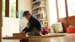 Candid shot of young boy playing alone in his room Stock Footage