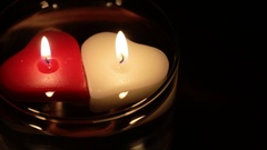 Two Floating Heart Shaped Candles Stock Footage