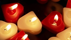 Close up of Floating Heart Shaped Candles Stock Footage