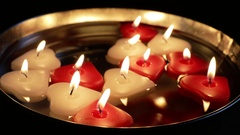 Floating Heart Shaped Candles Stock Footage