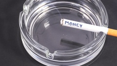 Combustion of word MONEY Writing on a cigarette in an ashtray. Stock Footage