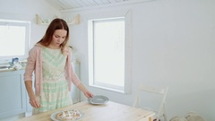 Beautiful girl slicing freshly baked apple pie. Stock Footage