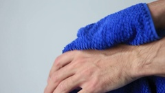 Man wiping his hands with a blue towel Stock Footage