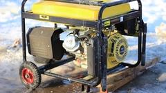 Diesel generator working in the street in wintertime Stock Footage