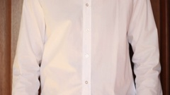 Businessman taking off his white shirt Stock Footage