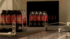 Bottles of Vyatka kvass are packaged on the conveyor Stock Footage