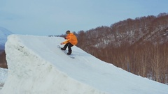 Snowboard rider jumping on mountains. Extreme snowboard freeride sport Stock Footage