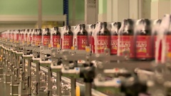 Bottles of Vyatka kvass is Packed on the Assembly line of a brewery Stock Footage