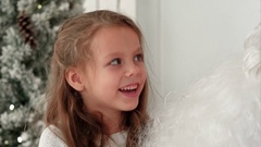 Cute little girl singing Christmas song together with Santa Claus Stock Footage
