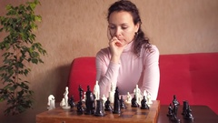 Girl playing chess Stock Footage