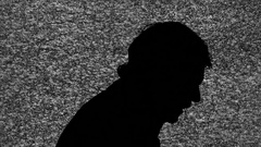 Silhouette tv noise gun nape man Stock Footage
