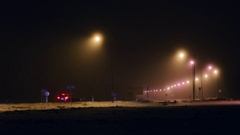 Headlights of passing cars at night. Stock Footage