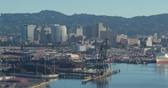 Aerial of container ship port and oakland city, California, USA Stock Footage