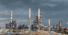 Big oil refinery with smoke stacks Stock Footage