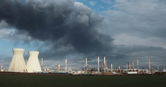 Big oil refinery with smoke stacks and black clouds over Stock Footage