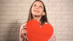 Teen girl withred big heart Stock Footage