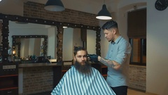 Attractive barber with dark hair wearing white shirt, watch and black gloves Stock Footage