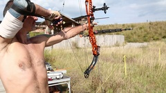 Archer shooting a bow at a target Stock Footage