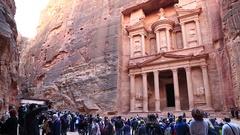 People near Al Khazneh or the Treasury at ancient Rose City of Petra in Jordan Stock Footage