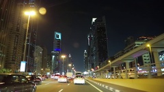 Evening city traffic along Sheikh Zayed road in Dubai, United Arab Emirates Stock Footage