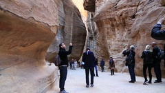 People in gorge that leads to Red Rose City Of Petra in Jordan Stock Footage