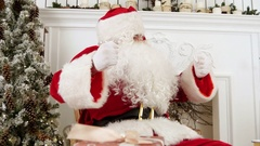 Santa Claus talking for the camera and wishing everyone merry Christmas Stock Footage