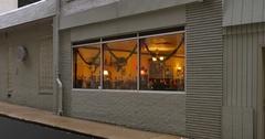 Man Walks Past Bar or Restaurant in Big City Stock Footage