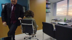 Playful Business Partners Man And Woman Messing Around With Chair At The Office  Stock Footage