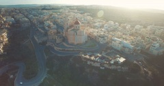 Aerial shot moving backwards over a village in Malta Europe Stock Footage