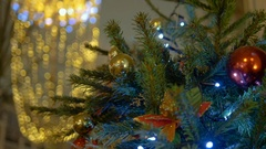New Year's balls hang on the Christmas tree, colored illumination Stock Footage