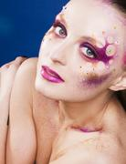 Beauty young woman with creative make up, mystery tinsel Stock Photos