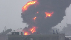Huge fire blaze from burning oil container in refinery Stock Footage