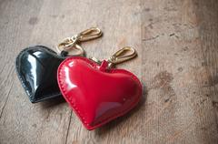 Hearts Key ring black and red on wooden background Stock Photos